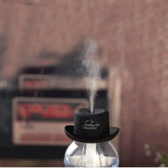 A cowboy hat USB charging mini bottle cap humidifier Household atomized small humidifier pink black