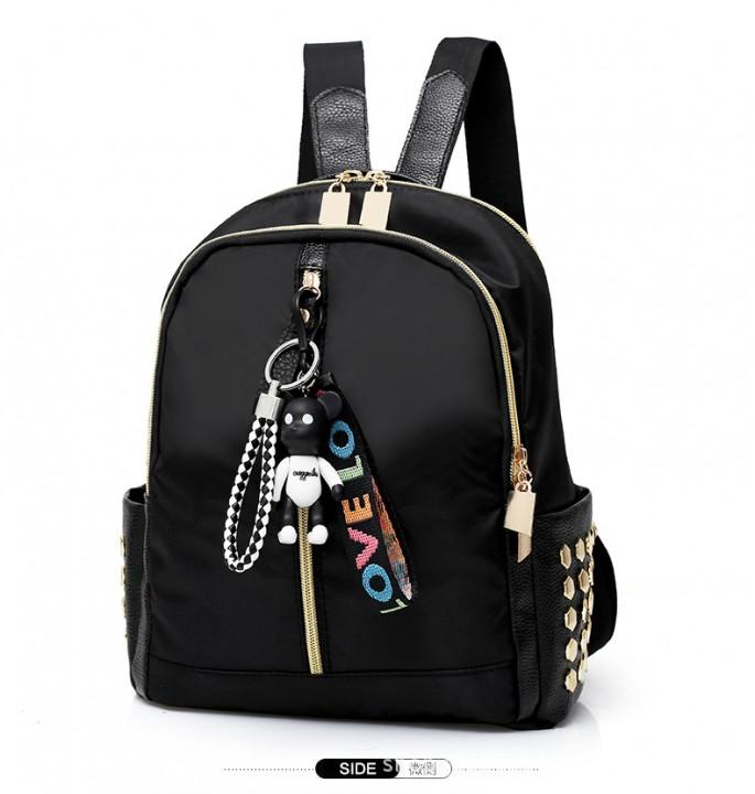 arrival female student backpack waterproof Oxford cloth leisure female rivet bag pendant zipper T