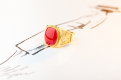 red and green  jewelry mounted with man's gold ring red normal
