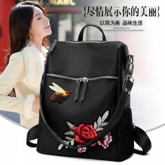 The new Korean version of the fashionable flower embroidery bag fashion large capacity backpack black 33*29*14