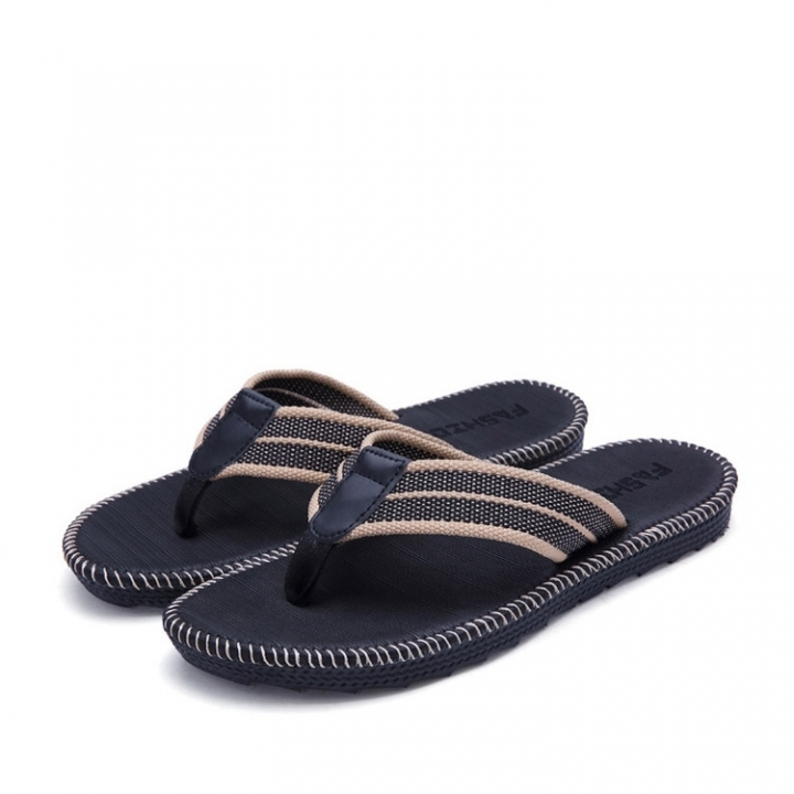 A Pair Of Flip-Flops For Men And Women On The Beach black 42