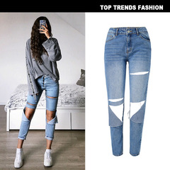 Women's straight, high-waisted jeans with nine-minute trousers worn in holes are versatile blue s