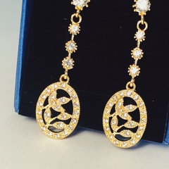 Floriane New Noble Luxurious Olive Branch Rhinestone Two Color Earring golden see information below