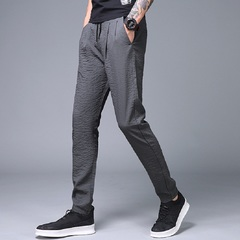 Summer thin mens casual Trousers ice silk pants new youth Korean version of small foot sweatpants Dark grey 28