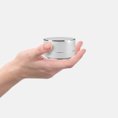 Bluetooth speaker MINI subwoofer color lamp is compact and lovely to carry with you silvery
