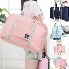 Large-capacity Folding Travel Shoulder Bag Waterproof Clothing Storage Bag pink