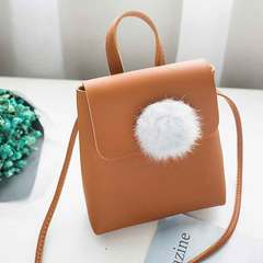 The new mini handbag is cute and versatile. It is a one-shoulder fur ball handbag brown 1 a