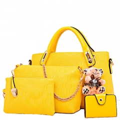 The new simple ladies handbag commuter stereotypes female bag five - piece mother package yellow referance details