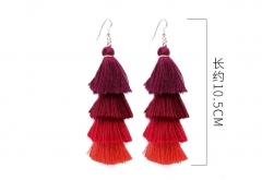 A long, multi-story handmade earring by Oumeiboximiya red as shown in the figure