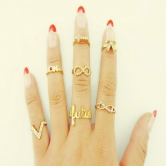 Fashion wind personality diamond 8 words V word bow cross 7 sets of rings ring ring ring gold free size